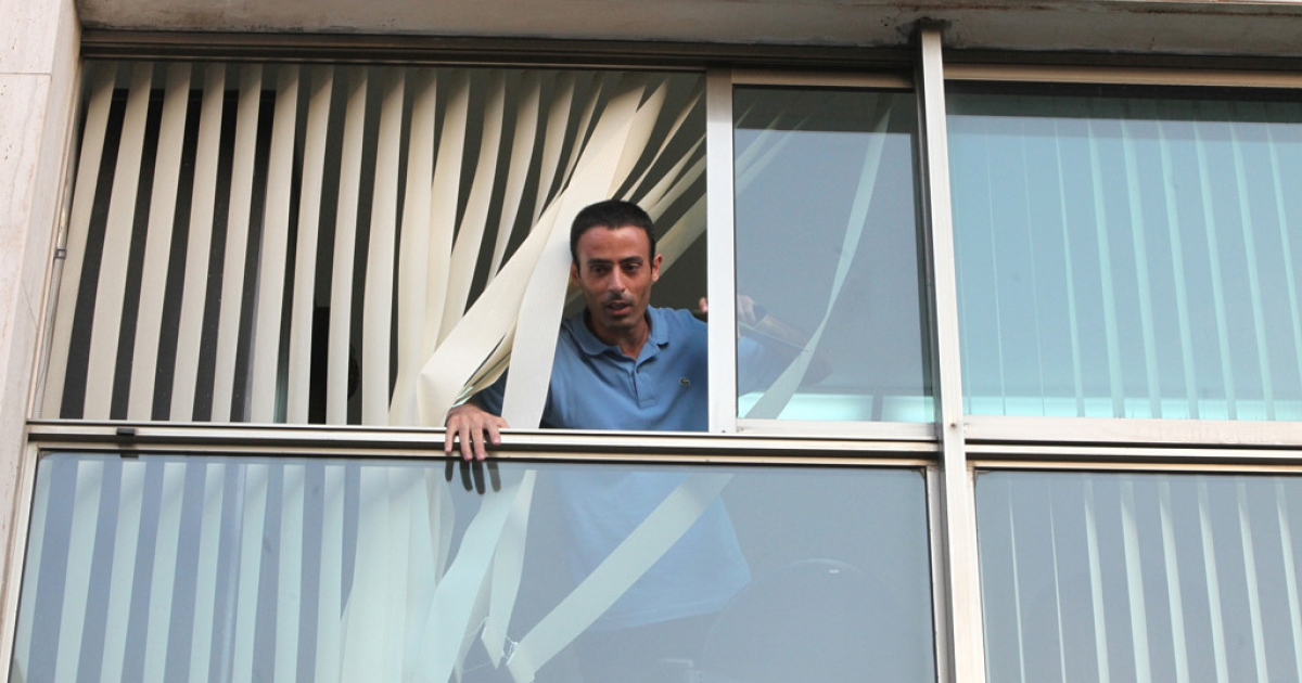 Palestinian Nadim Injaz is seen at the window of the Turkish Embassy in Tel Aviv, on August 17, 2010. Injaz, allegedly carrying a knife and a toy gun broke into the embassy and attempted to take a diplomat hostage before being overpowered by security, Turkish officials and media said.</p>