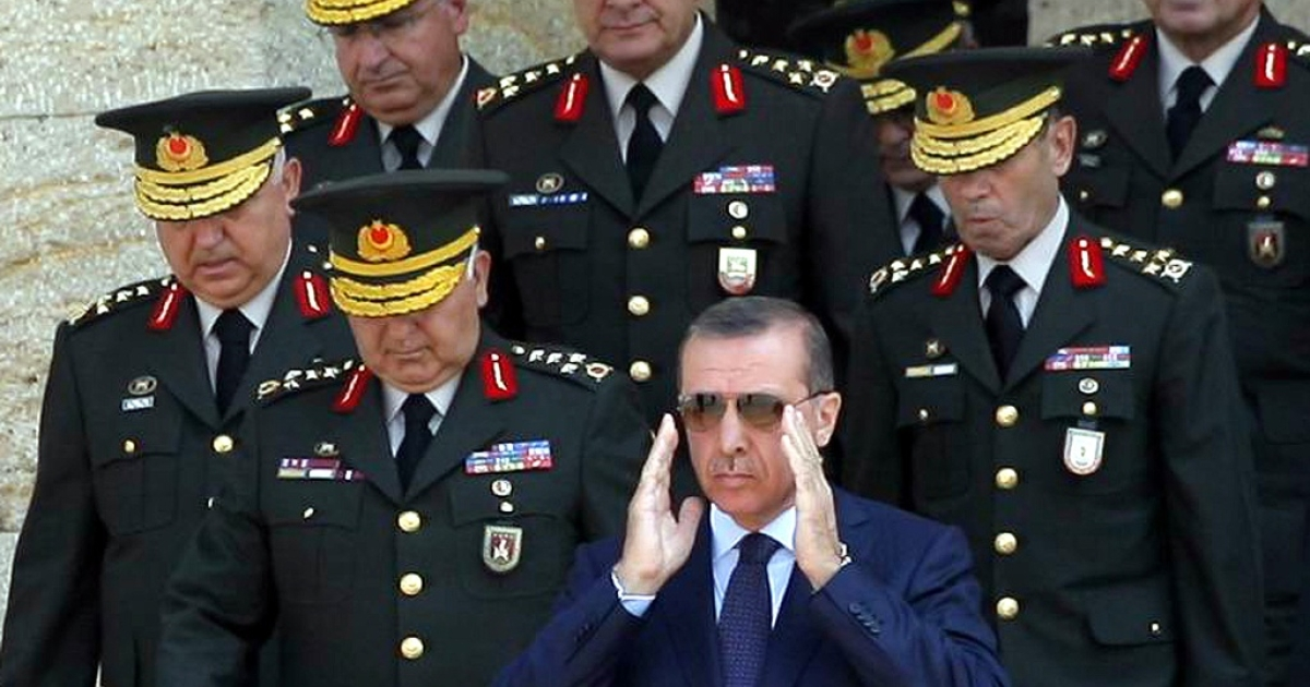Turkey's Prime Minister Tayyip Erdogan is flanked by military commanders in Ankara on Aug. 1, 2011.</p>