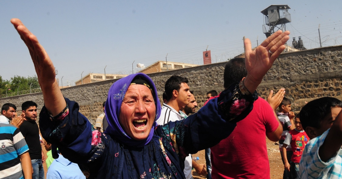 A relative of a prisoner cries in front of Sanliurfa city prison on June 17, 2012.</p>