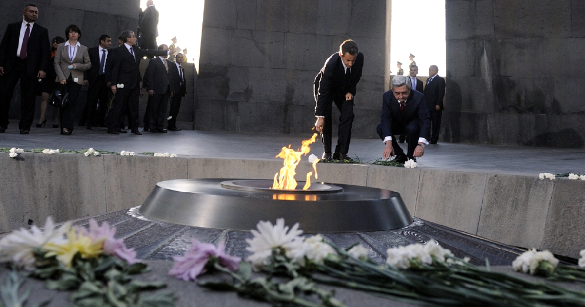 French President Nicolas Sarkozy (left) and Armenian president Serge Sarkisyan visit the Tsitsernakaberd Armenian Genocide Memorial Museum in Yerevan on October 6, 2011. Turkey is enraged that France may pass a bill making it illegal to deny the genocide.</p>