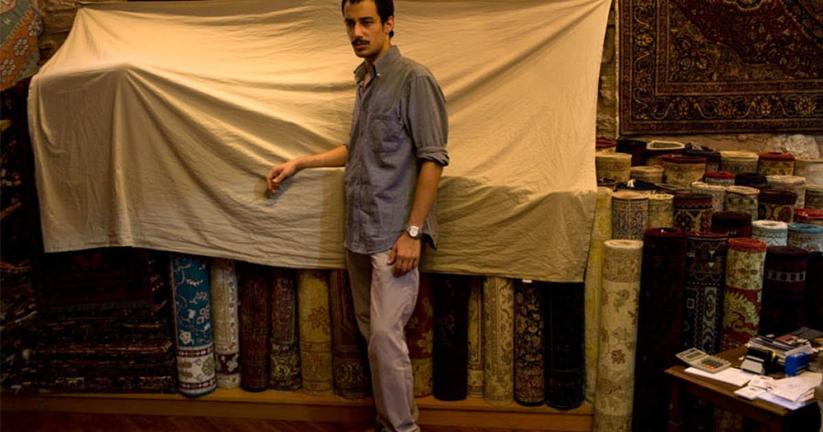 Ercan Karaismail, 22, is an assistant in carpet shop.</p>