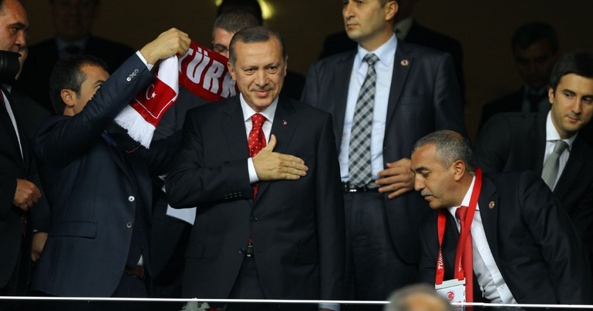 Turkey's Prime Minister Tayyip Erdogan arrives in the stands before the FIFA World Cup 2014 qualification football match between Turkey and Romania in Istanbul, on October 12, 2012.</p>