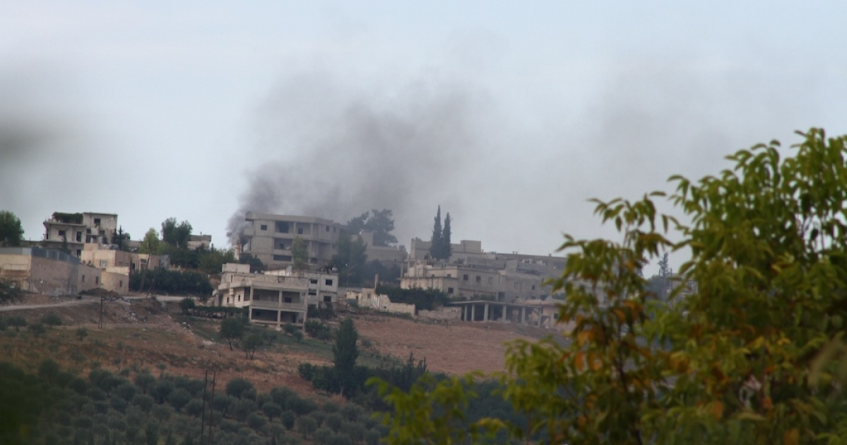 Azmarin, seen from the Turkish/Syrian border, after the rebels attacked government forces in the city on Friday.</p>