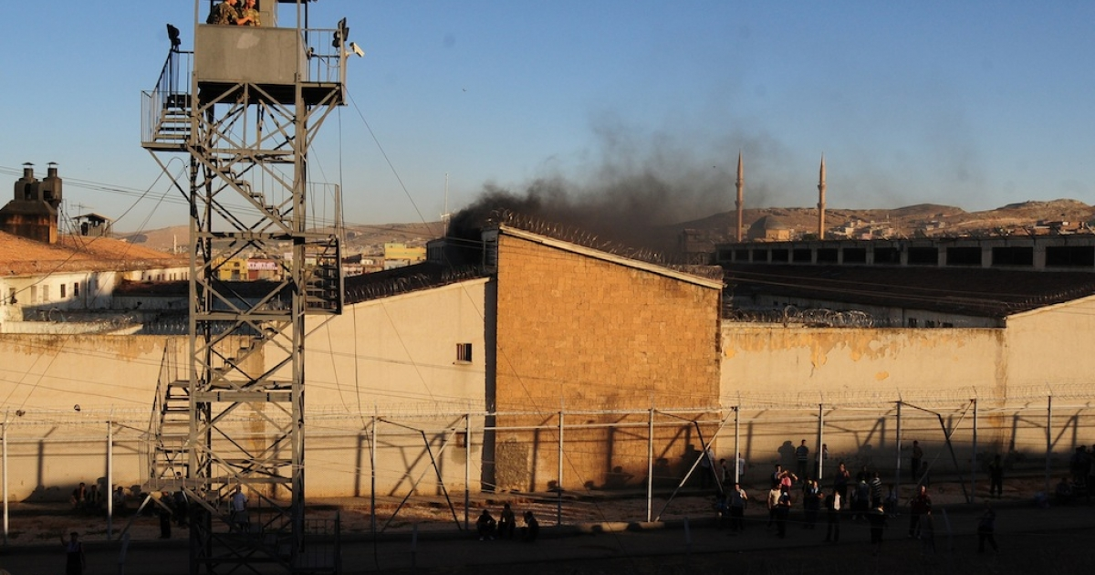 Smoke rises from Sanliurfa city prison in June, 2012, in Sanliurfa, Turkey. The prison saw a riot and two fires in a month, just one of Turkey's many prisons facing what a new report called