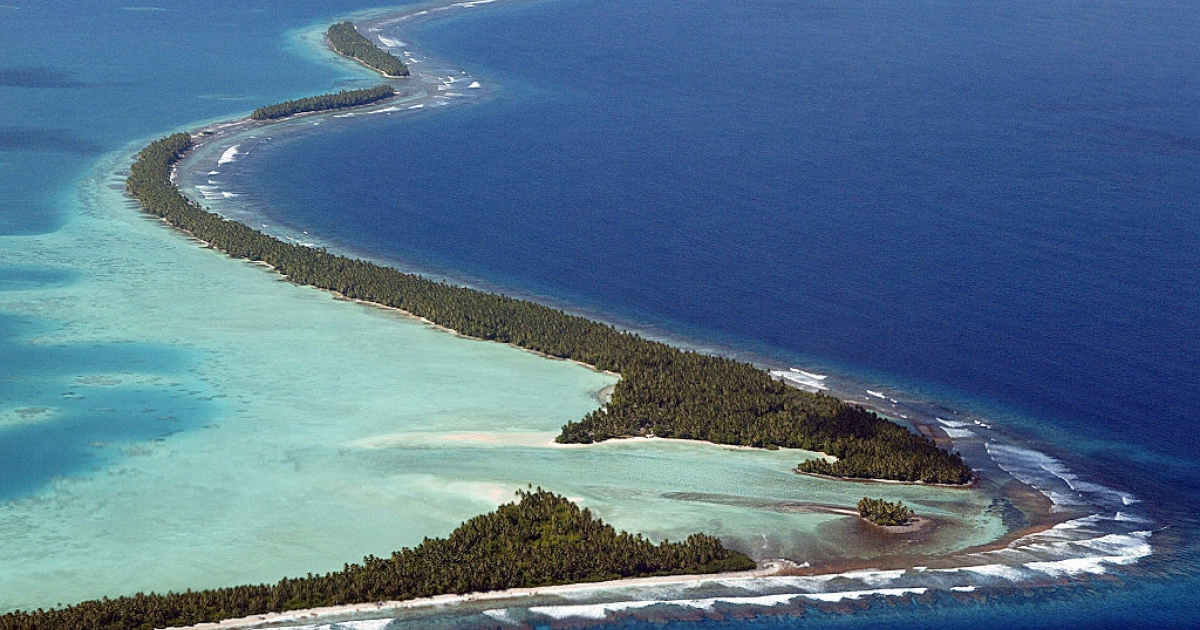 King tides in the South Pacific swallow the coastline of Funafuti Atoll, 19 February 2004, home to nearly half of Tuvalu's entire population of 11,500.</p>