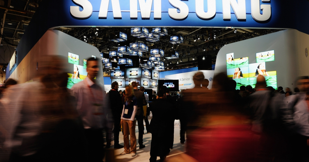Samsung Electronics Co. televisions sit on display at the 2012 International Consumer Electronics Show at the Las Vegas Convention Center January 10, 2012 in Las Vegas, Nevada. The company, along with Sony, is scaling back on its TV discounts in an attempt to curb declining profit margins.</p>