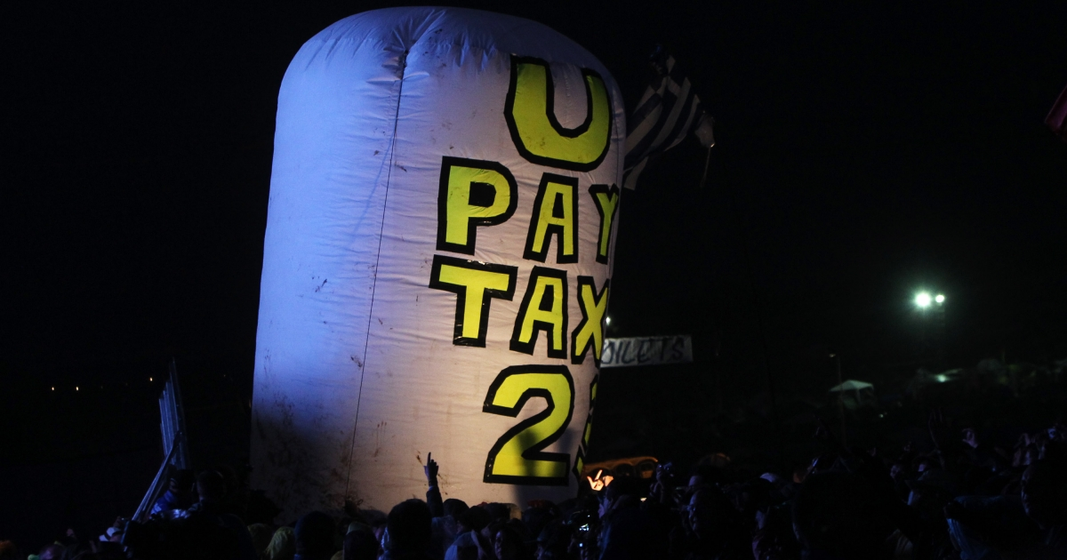 A protest against U2 at the Glastonbury Festival on June 24, 2011 in Glastonbury, England.</p>