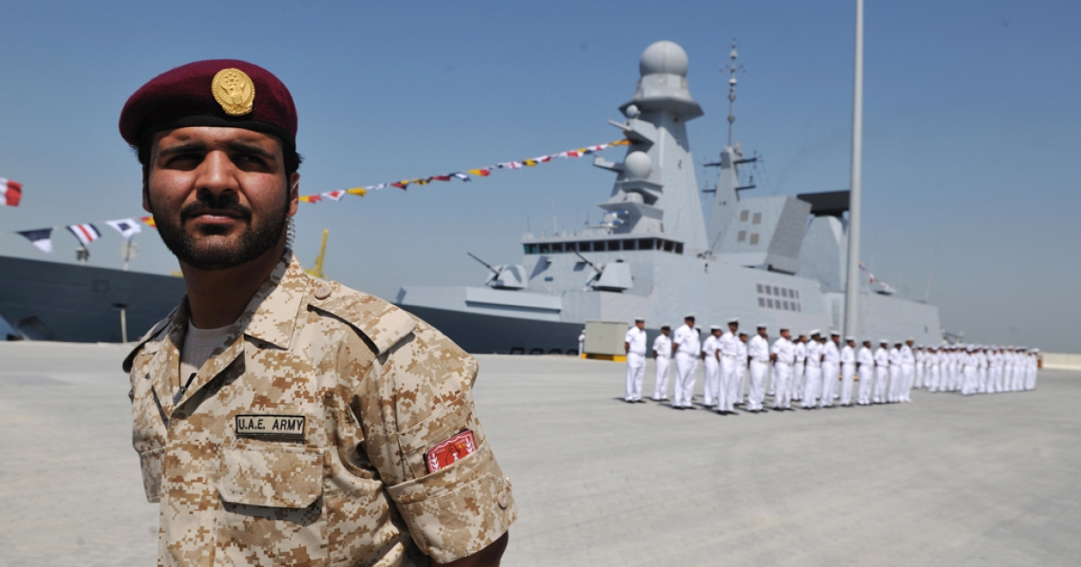An Emirati soldier stands guard in front of the French navy frigate in 2009. A new pipeline in the United Arab Emirates would help reduce reliance on the Strait of Hormuz for oil exports to the West.</p>