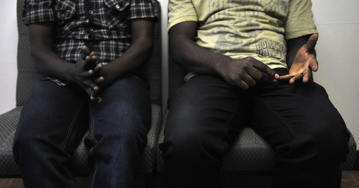 This picture taken on Jan. 12, 2012 shows a gay couple, who wish to remain anonymous. They faced deadly persecution in their home country and fled to Nairobi, Kenya. The new anti-homosexuality bill in neighboring Uganda touched off a wave of homophobia, an example of an increasing incidence of openly hostile environment for LGBT individuals.</p>