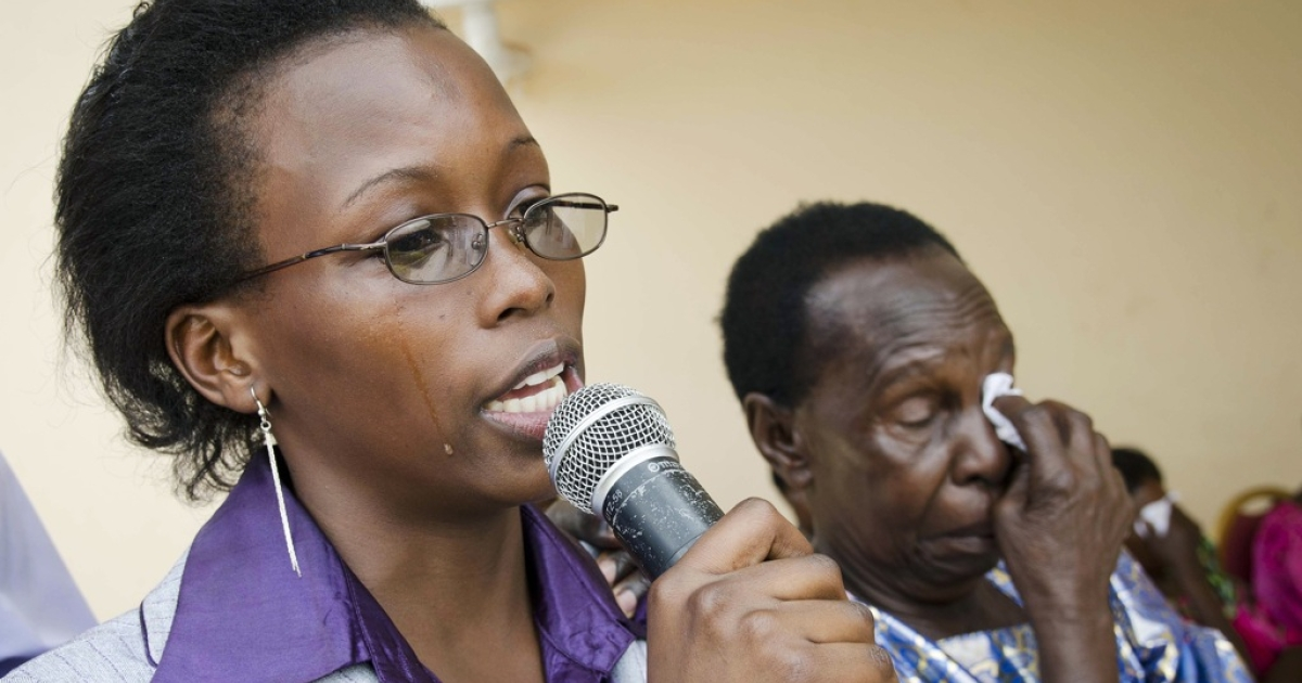 Sister of gay Ugandan activist David Kato, Eva Mulumba (L) cries as she gives a speech beside Kato's mother, Nalango Lydia Mulumba (R) during a memorial service for Kato in Kampala, on January 26, 2012. Kato served as a Advocacy and Litigation Officer for sexual minorities in Uganda. Kato was brutally murdered at the age of 46 years his home in Kyetume, Mukono District on January 26, 2011.</p>