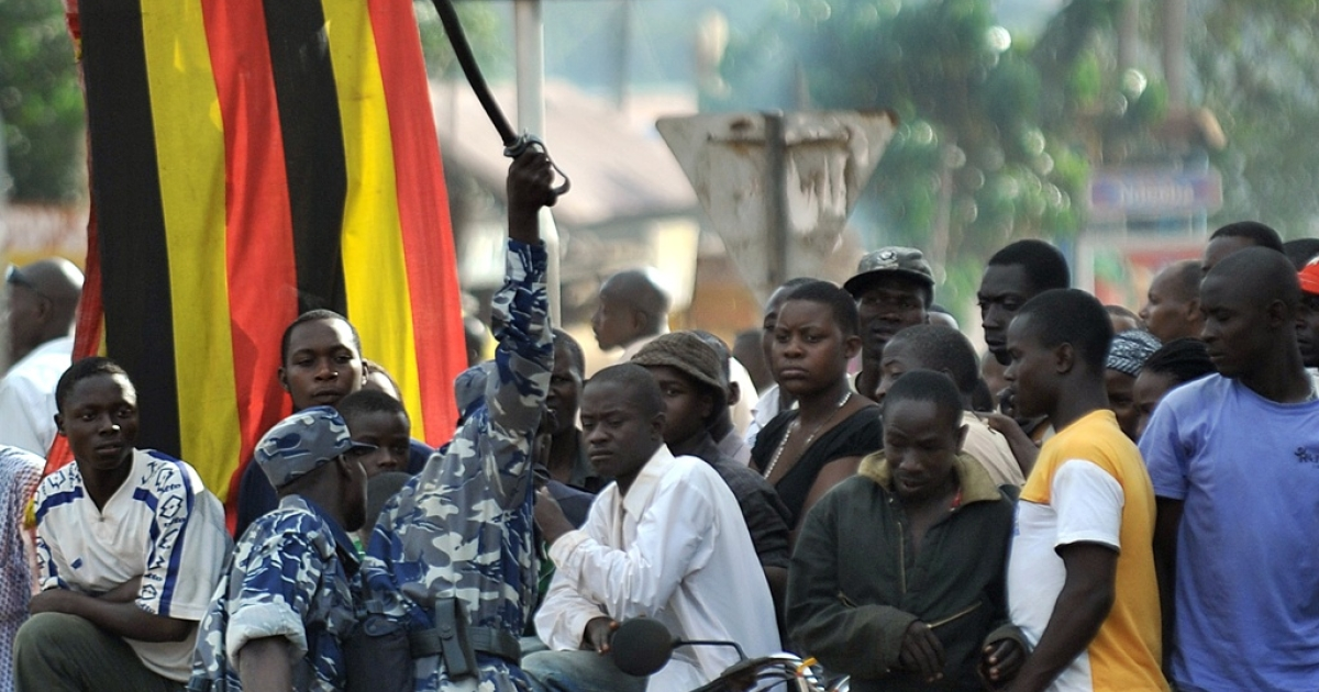 A Ugandan security officer swings his baton at members of a crowd gathered to welcome opposition leader, Kizza Besigye, scheduled to arrive from Kenya, on May 11, 2011. Besigye was blocked from from boarding the flight to Uganda. The incident came on the eve of the swearing-in ceremony for President Yoweri Museveni, who won re-election after February polls in which Besigye mounted the strongest challenge yet to his 25-year rule.</p>