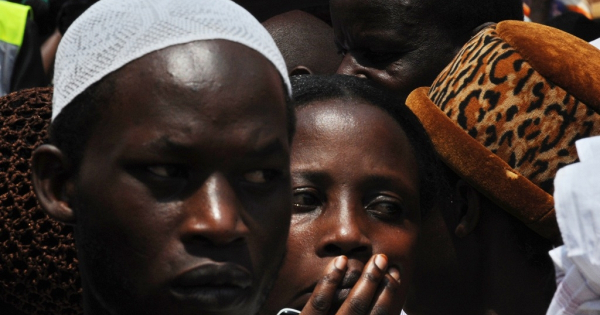 Voters wait in line at a polling station in the Ugandan capital Kampala on Feb. 18, 2011.</p>