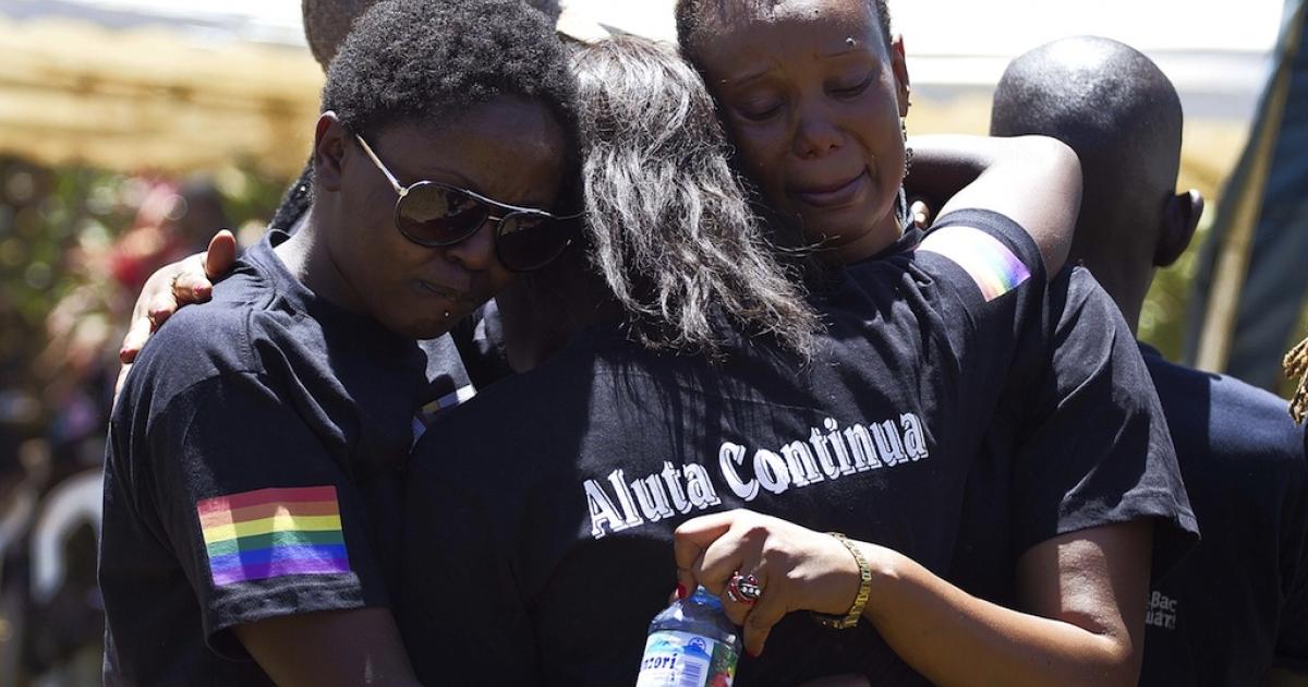 Members of the Ugandan gay community mourn at the funeral of murdured activist David Kato near Mataba on Jan. 28, 2011.</p>