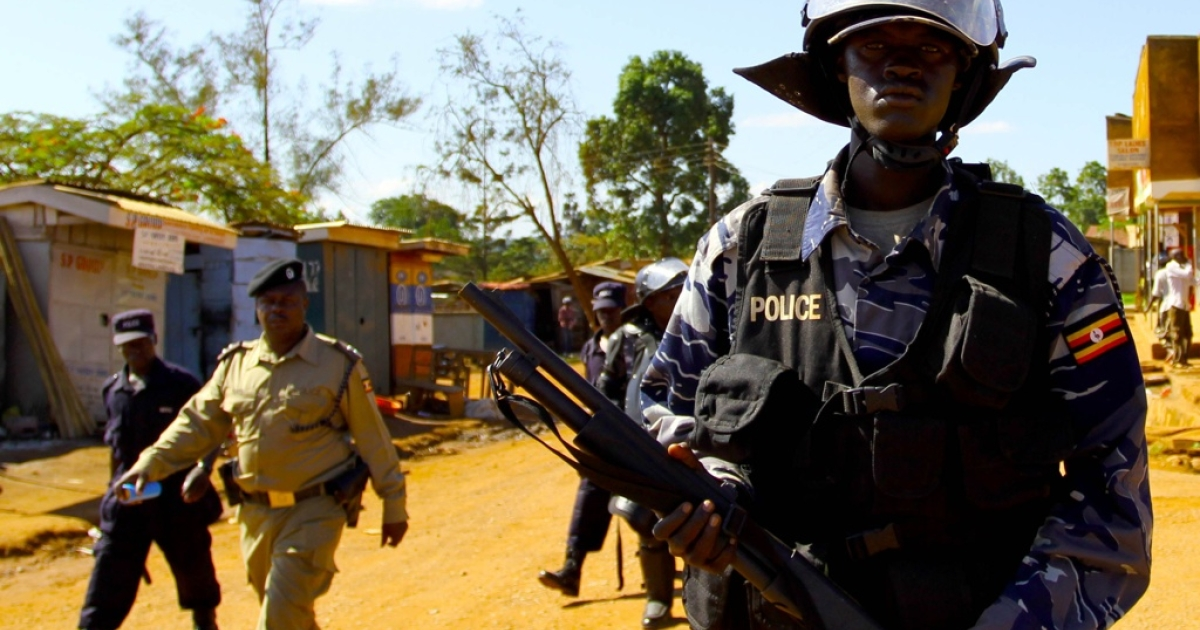 Ugandan policemen patrol on the streets of Kasangati, a suburb of Kampala, to stop a protest by opposition leader Kizza Besigye as he tried to stage a protest against rising prices.</p>