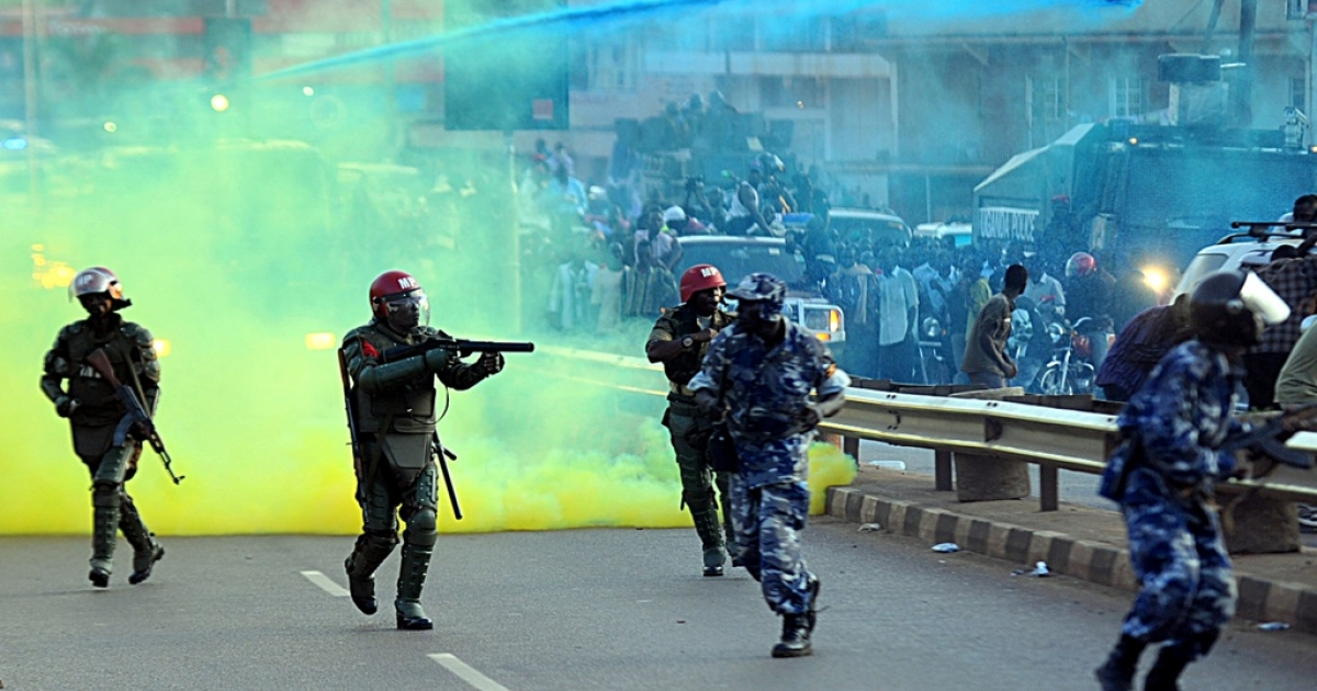 Ugandan anti-riot forces fire tear gas to disperse supporters of Ugandan opposition leader Kizza Besigye rallying to welcome the opposition leader back to Kampala from Nairobi on May 12, 2011. Besigye's supporters overshadowed the inauguration of Ugandan President Yoweri Museveni to a fourth term. Museveni vowed to stamp out 'disrupting schemes' on May 12.</p>