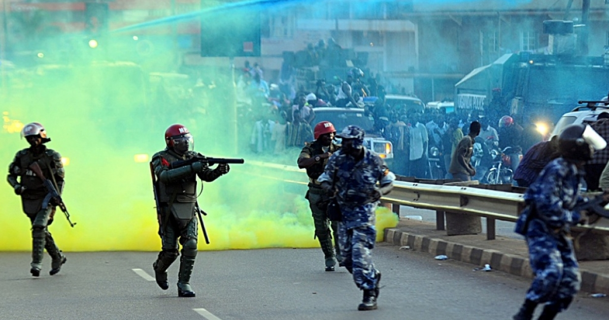 Ugandan anti-riot personnel fire tear gas to disperse supporters of Ugandan opposition leader Kizza Besigye on May 12, 2011. Ugandan President Yoweri Museveni denounced journalists as