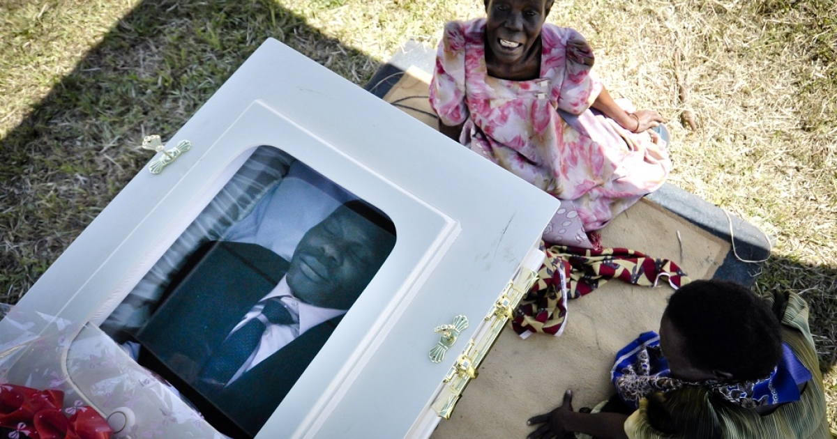 A woman mourns at the funeral of murdered activist David Kato near Mataba, on January 28, 2011. Although the police claims it was most likely a petty crime, targeting Kato's money, many members of the gay and the human rights community hold the Ugandan government responsible for not battling the growing resentments against homosexuals in the Ugandan society. Homosexuality is illegal in many African countries and is punishable by a prison sentence.</p>