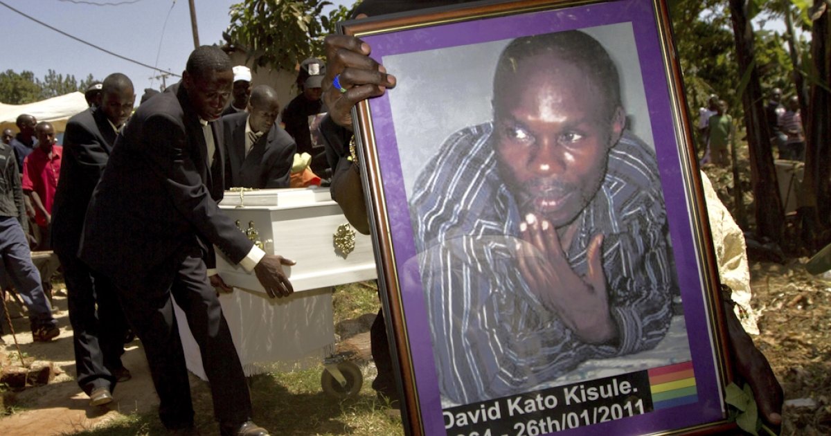 A member of the Ugandan gay community carries a picture of murdered gay activist David Kato during his funeral near Mataba, on January 28, 2011. Although the police claims it was most likely a petty crime, targeting Kato's money, many members of the gay and the human rights community hold the Ugandan government responsible for not battling the growing resentments against homosexuals in the Ugandan society. Homosexuality is illegal in many African countries and is punishable by a prison sentence.</p>