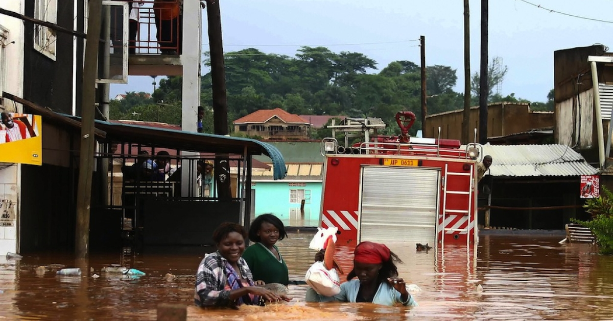 Littering contributes to flood disasters. Here, Ugandan residents cross a flooded street on the road to Entebbe in the Namasuba neighborhood in Kampala after a heavy downpour earlier in the day. Heavy rains pounded the Ugandan capital early November 16, 2007 flooding homes and submerging vehicles only weeks after the region suffered the worst floods in decades.</p>