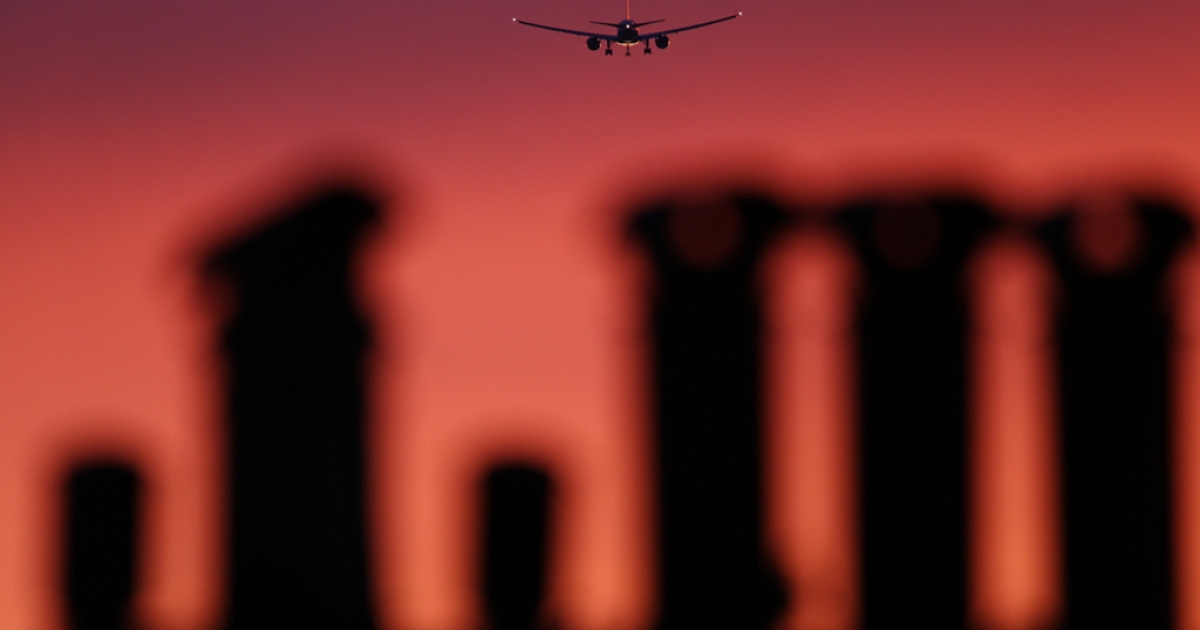 An airplane comes in to land at Heathrow airport at sunset on April 2, 2011 in London, England.</p>