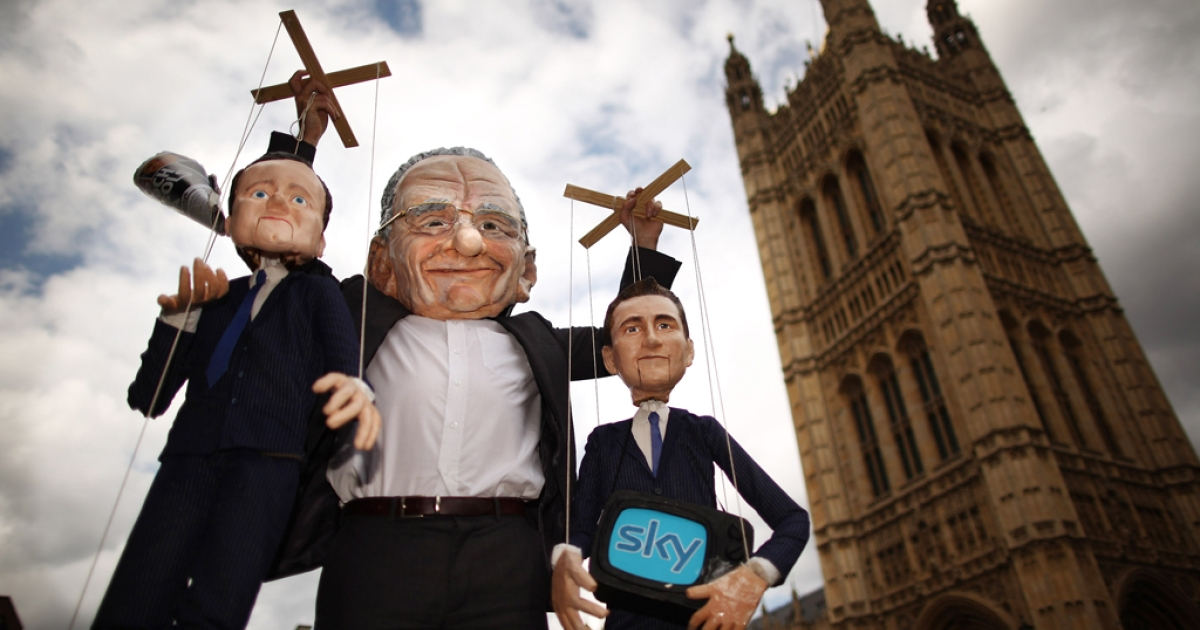 Dummies and puppets representing Prime Minister David Cameron (L) and Culture Secretary Jeremy Hunt (R) are held aloft by Rupert Murdoch at the launch of the campaign group Hacked off near Parliament on July 6, 2011 in London, England.</p>