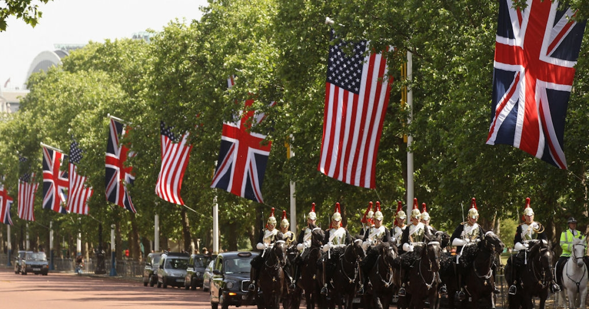 Soldiers on horseback march along the Mall past American and British national flags on May 23, 2011 ahead of the visit by U.S. President Barack Obama and First Lady Michelle Obama to London, England.</p>