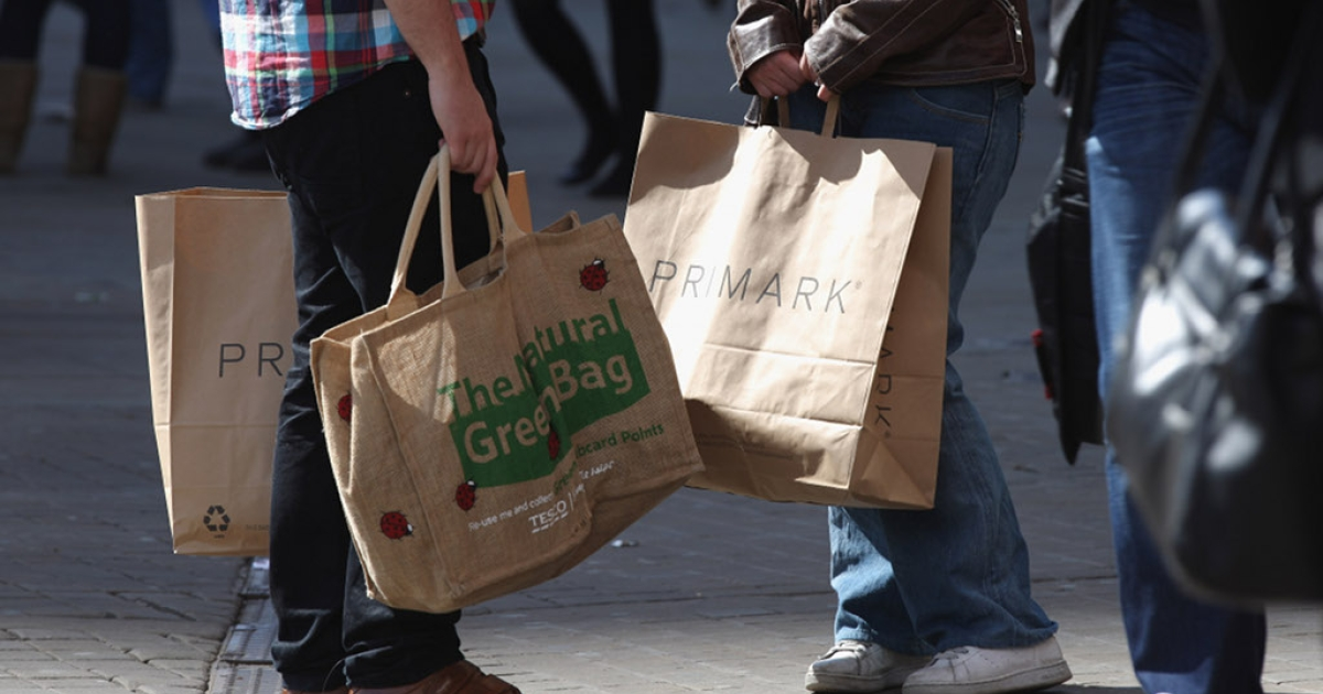 Consumers are seen with shopping bags on April 12, 2011. U.S. consumer confidence hit a one-year high in February as optimism over the job market outweighed concern over rising gas prices.</p>