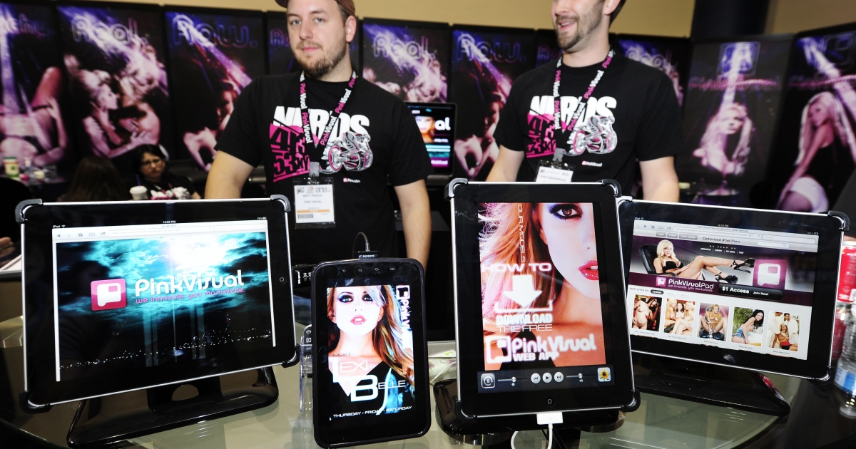 The iPads and one Samsung Galaxy (2L) with pornography applications are on display at the Pink Visual booth at the AVN Adult Entertainment Expo Jan. 9, 2011 in Las Vegas, Nevada. Iceland is considering banning Internet pornography within its borders, which would make it the first Western nation to impose such a restriction.</p>
