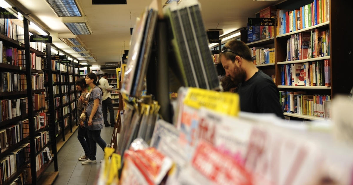 People browse literature at a bookstore on August 3, 2011.</p>