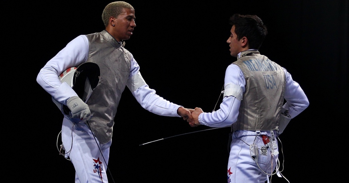 Miles Chamley-Watson of the USA shakes hands with Gerek Meinhardt of the USA after the final of the Men's Foil Individual at the Fencing Invitational, part of the London Prepares series in Nov. 2011.  British athletes will have to think twice about extending their hand after the British Olympic Association's cheif medical officer warned of the dangers of possible injury and infection.</p>