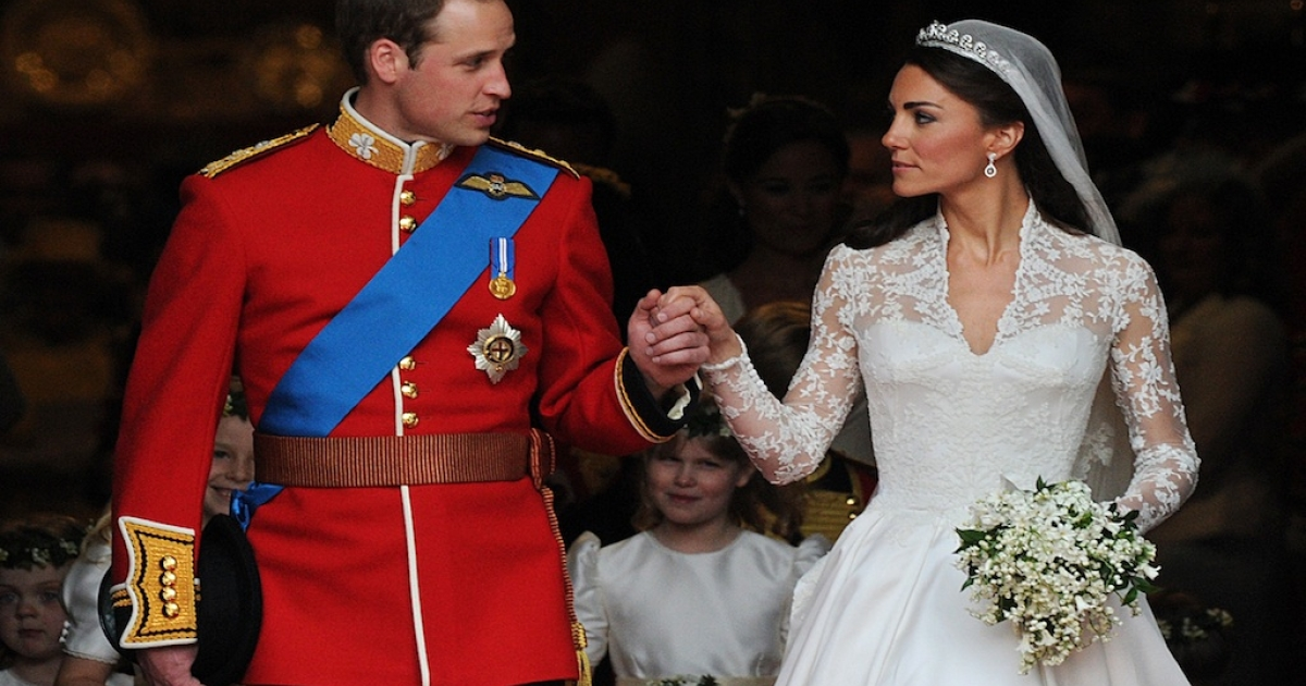Britain's Prince William and his wife Kate, Duchess of Cambridge, look at each other as they come out of Westminster Abbey following their wedding ceremony in London on April 29, 2011.</p>