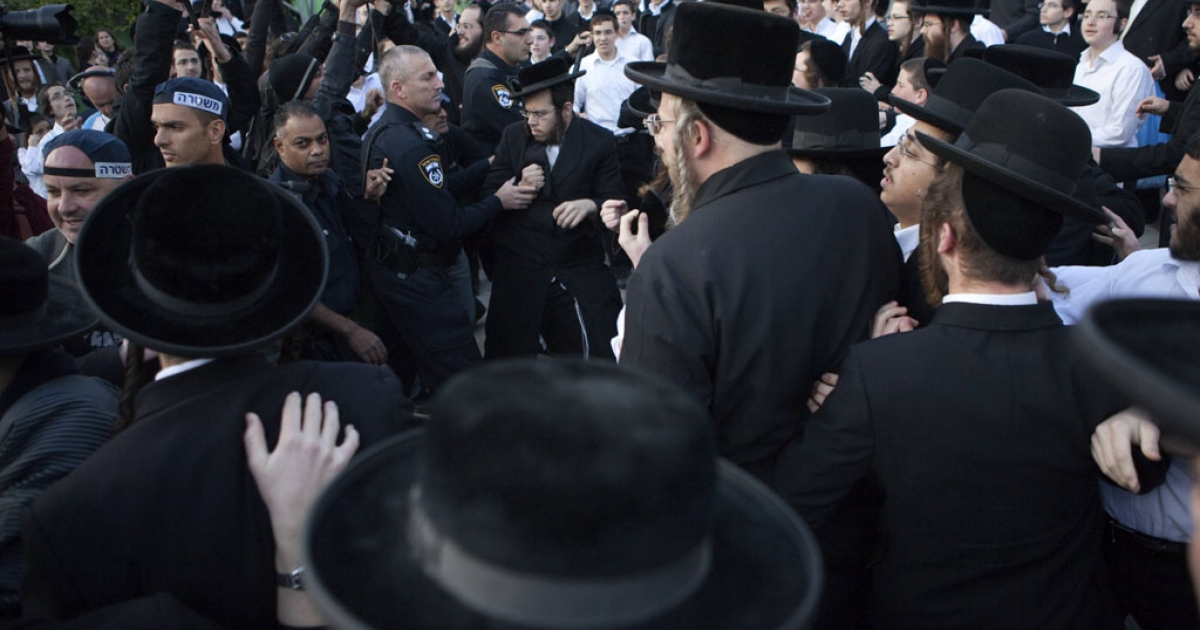 Israelis policemen disperse ultra-Orthodox Jewish protesters in the central town of Beit Shemesh, near Jerusalem, on Dec. 26, 2011. Extra Israeli police patrolled the streets of Beit Shemesh after a campaign by ultra-Orthodox Jews to segregate men and women erupted into violence.</p>