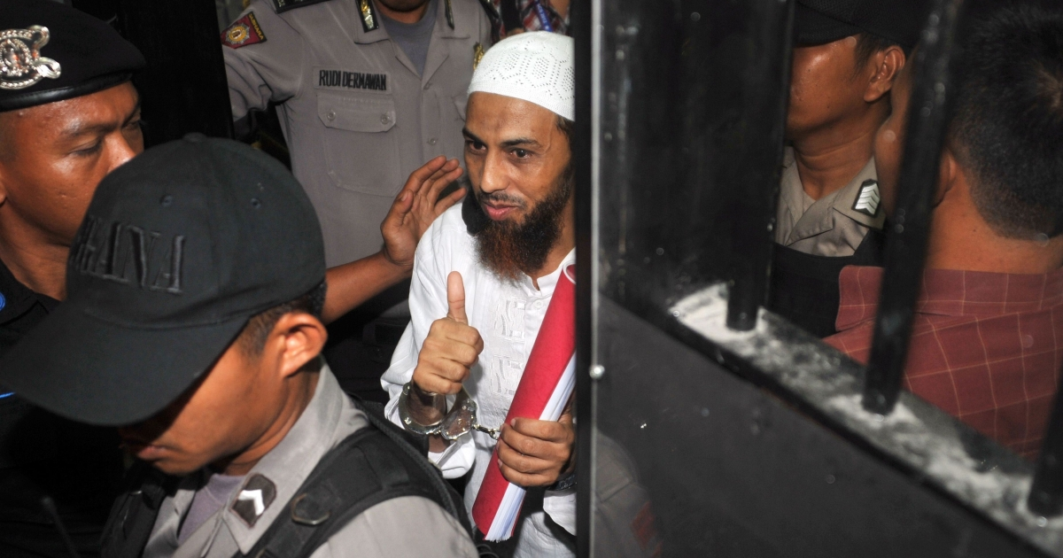 Umar Patek arrives at the West Jakarta court in February in an armored vehicle, escorted by police commandos.</p>