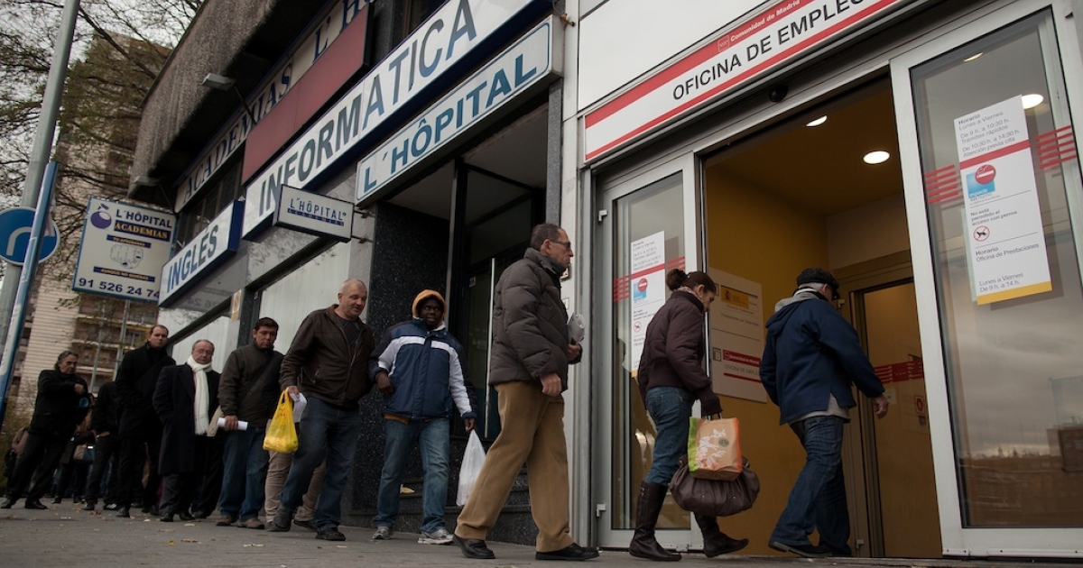 People queue to enter a government employment office in Madrid on December 4, 2012.</p>