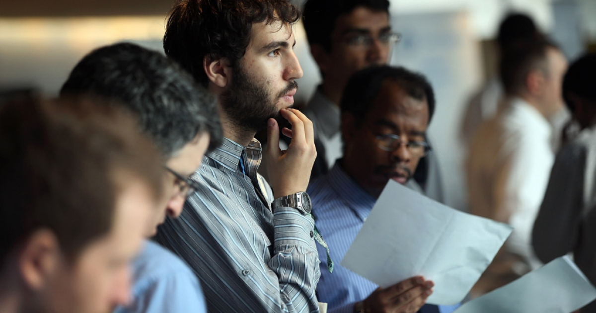 Job applicants wait to meet potential employers at the NYC Startup Job Fair held at 7 World Trade Center on September 28, 2012 in New York City.</p>