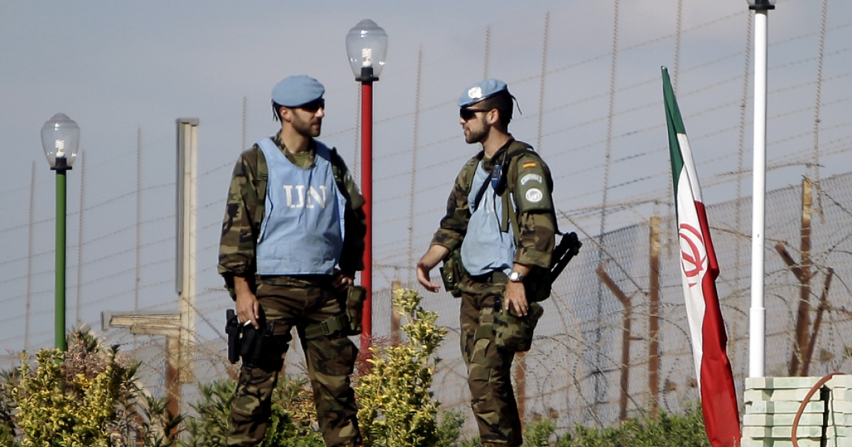 UNIFIL peacekeepers stand at the border between Lebanon and Israel. Five peacekeepers were injured on Friday when a roadside bomb detonated beside their van.</p>