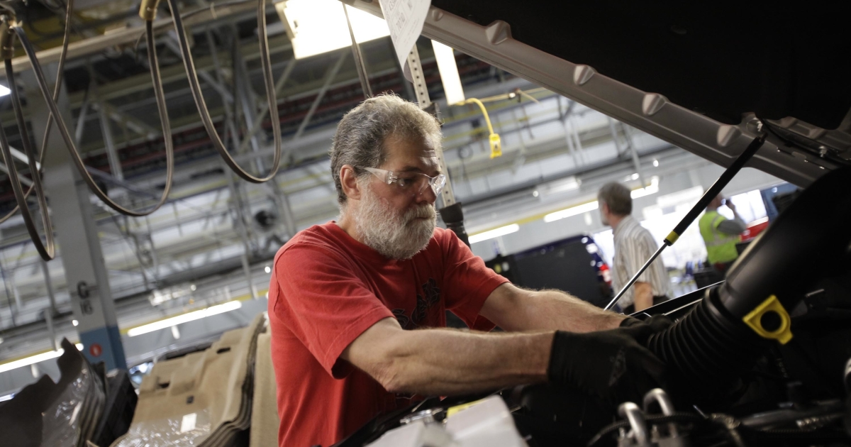 A union worker installs a part into a vehicle at the Chrysler Toledo Assembly Complex in Toledo, Ohio, on Nov. 16, 2011.</p>