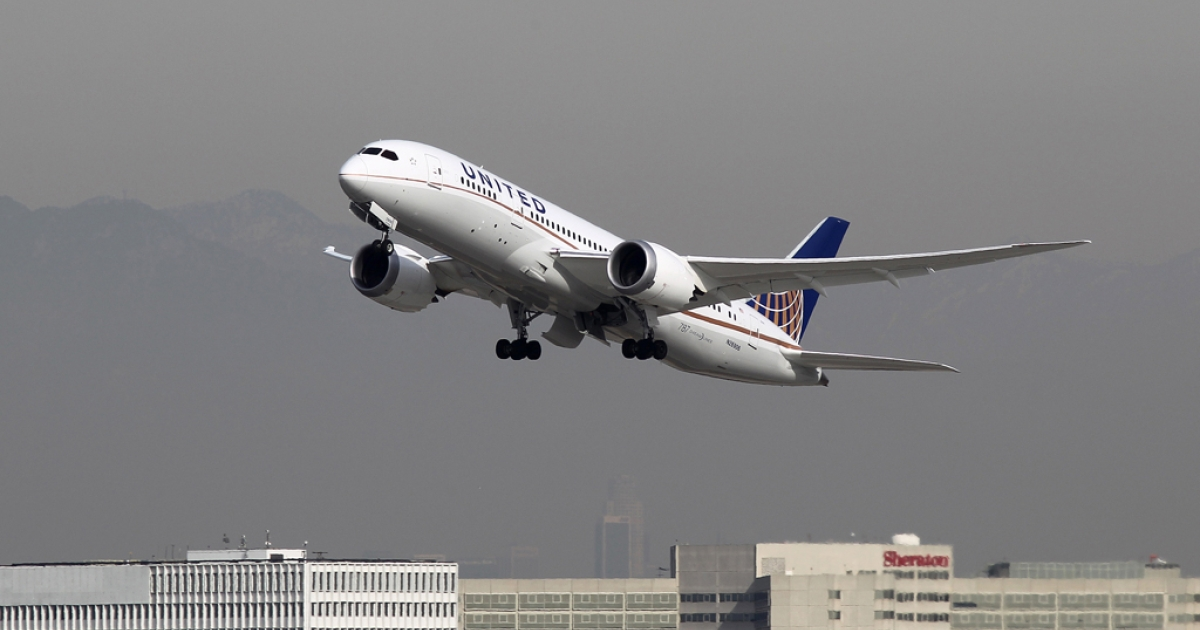 A Boeing 787 Dreamliner, operated by United Airlines, takes off from Los Angeles International Airport (LAX) on Jan. 9, 2013, in Los Angeles, Calif. On Wednesday United implemented its second price change of 2013, with shorter trips going up $4 and longer distance routes increasing by $20 round-trip.</p>