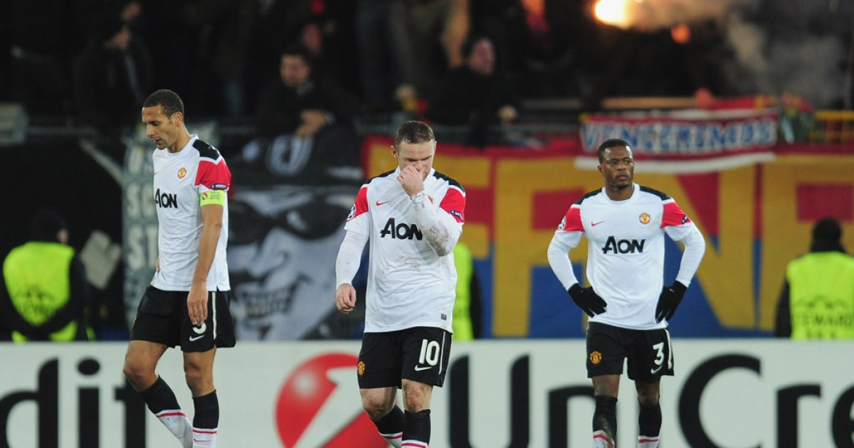 It takes more than money to win:  Manchester United players headed by Wayne Rooney leave field after defeat last night against FC Basel</p>
