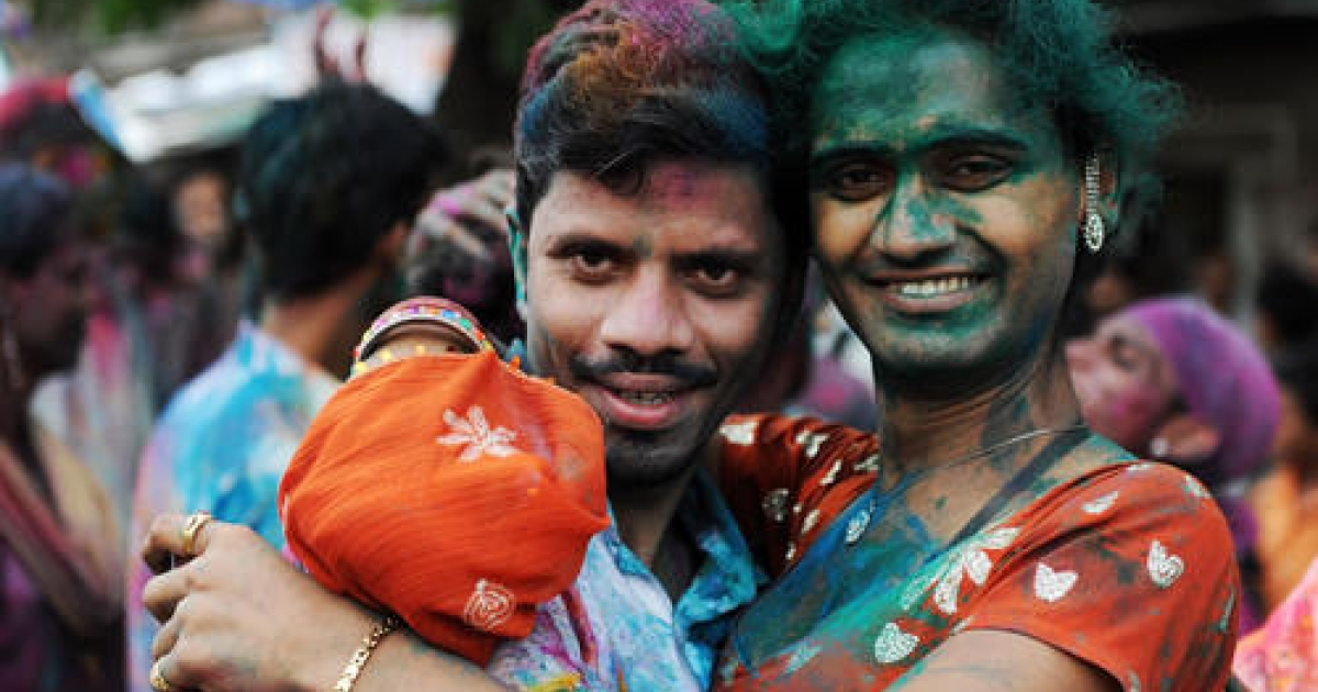 A eunuch poses with her partner during a rally by members of the transgender, gay and lesbian communities to celebrate an Indian court's ruling decriminalising gay sex between consenting adults, in Mumbai on July 1, 2009.</p>
