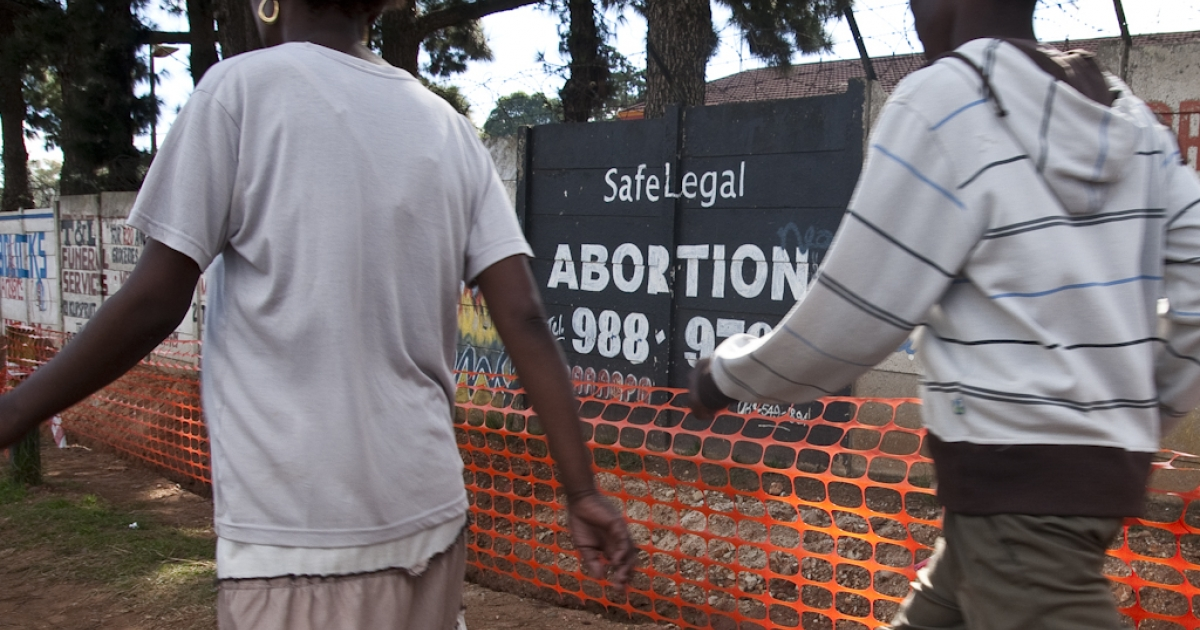 An abortion advertisement along a busy street in Soweto, South Africa. While abortion is legal in government-approved clinics in South Africa, this advertisement is an example of the growing number of unapproved abortion practitioners in the country. The World Health Organization has warned that global abortion rates are rising, putting women's health at risk. A WHO study says that 97 percent of abortions performed in Africa can be described as unsafe.</p>