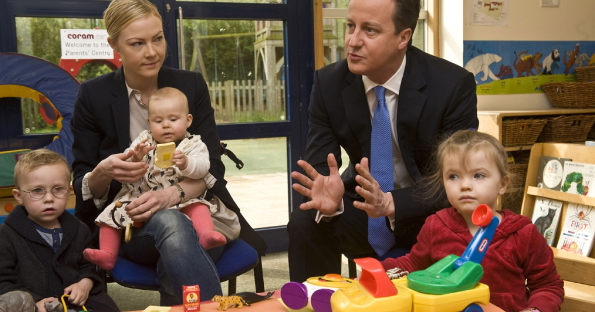 Prime Minister David Cameron talks to parents in London, England.</p>