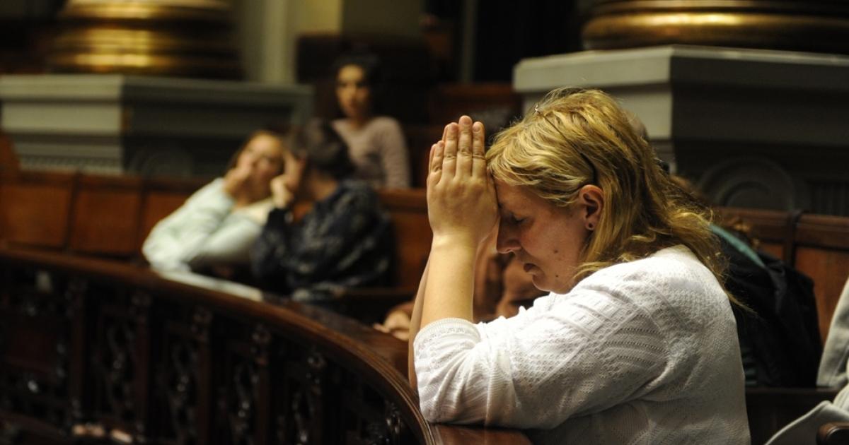 A Uruguayan woman prays at Uruguayan senate as lawmakers debate legalizing abortion on Oct. 17.</p>