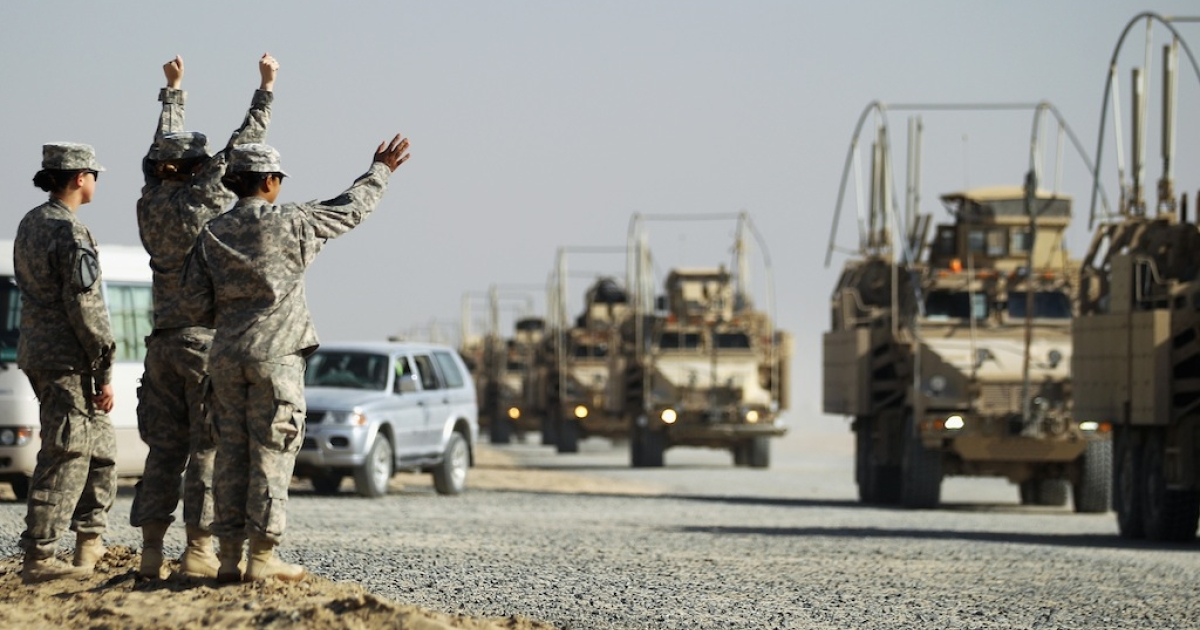 Soldiers wave to colleagues as a section of the last American military convoy to depart Iraq from the 3rd Brigade, 1st Cavalry Division arrives after crossing over the border into Kuwait on December 18, 2011, in Camp Virginia, Kuwait.</p>