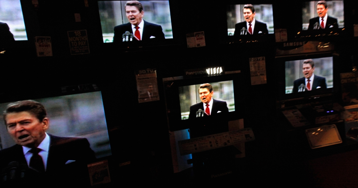 Dozens of televisions display a political advertisement with the image of former President Ronald Reagan, Dec. 27, 2011 in Urbandale, Iowa.</p>