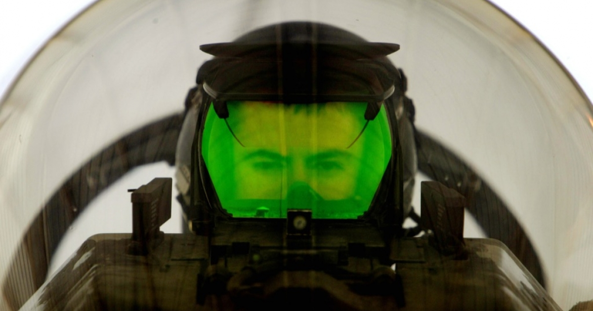 A U.S. Air Force pilot looks through the Heads Up Display (HUD) of his F-16