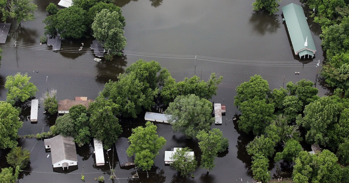 A church and homes are seen in the Mississippi River floodwaters on May 23, 2011 in Vicksburg, Miss.</p>
