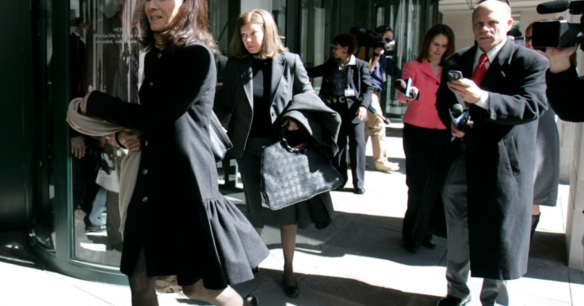 Jenny Sanford,left, is followed by media as she leaves Charleston County Courthouse after she was granted a divorce on grounds of adultery from South Carolina Gov. Mark Sanford February 26, 2010 in Charleston, South Carolina.</p>