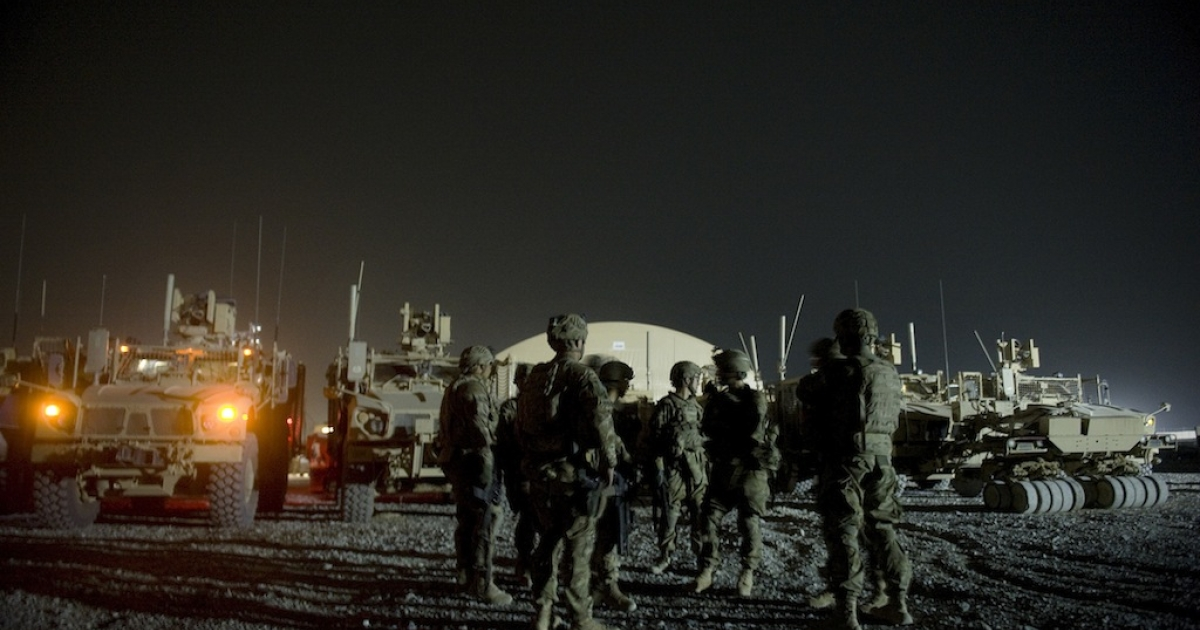 Infantry men  attend a briefing prior to embarking on a night patrol from Lindsey foward operating base on Sept. 15, 2012 in Kandahar province, Afghanistan. Two NATO soldiers were shot dead that day by a man believed to be a member of a Afghan police force in southern Afghanistan, the US-led military said.</p>
