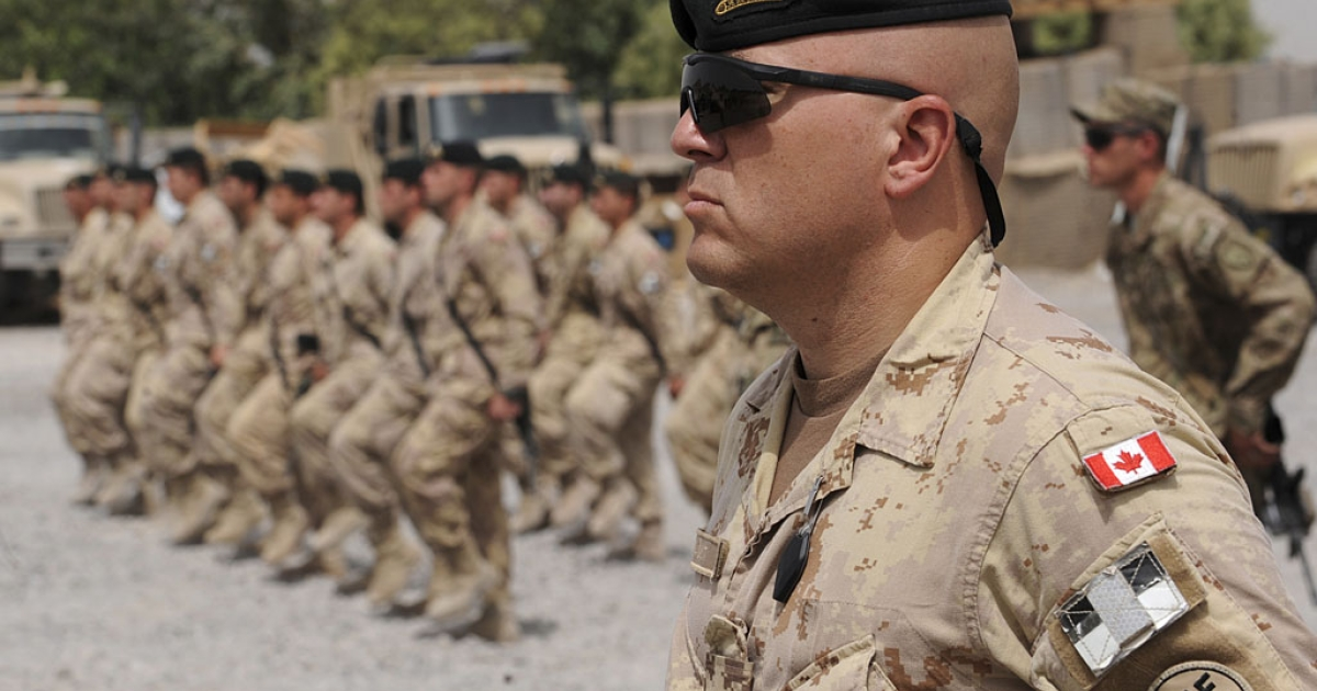 Canadian soldiers march at Forward Fire Base Masum Ghar in Kandahar, Afghanistan, on July 5, 2011. The US has asked Canada and Australia to keep forces in Afghanistan past the expected 2014 end of the NATO mission.</p>